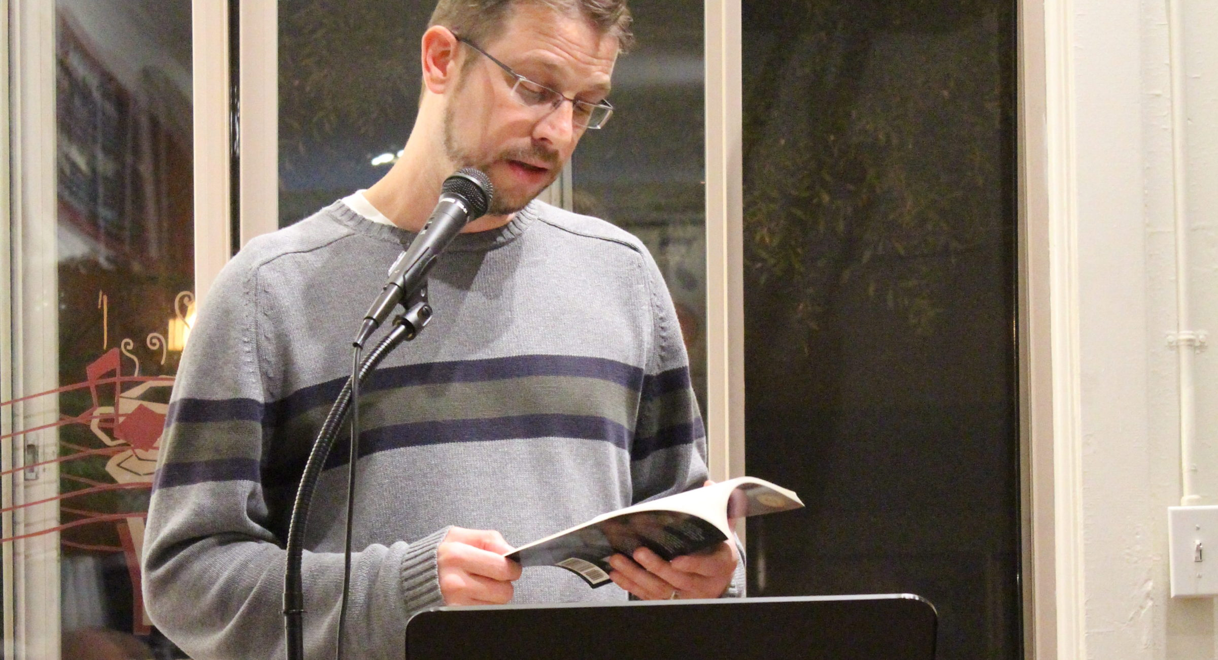Reno, NV Poet Laureate, Lindsay Wilson, reads from his book, No Elegies, at Cafe Society. October 10th, 2017.